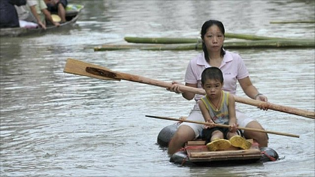 Mother and child on a raft in China