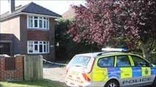 A police car outside the family home in Felpham, Bognor