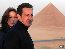 (Photo from 2007) French President Nicolas Sarkozy and Carla Bruni watch the sunset over the Great Pyramids in Giza near Cairo