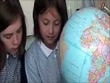 Children look a globe