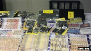Cash and equipment seized in Hong Kong raids