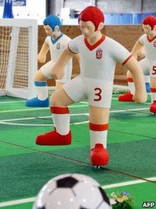 Plastic football players at an art exhibition in Tokyo