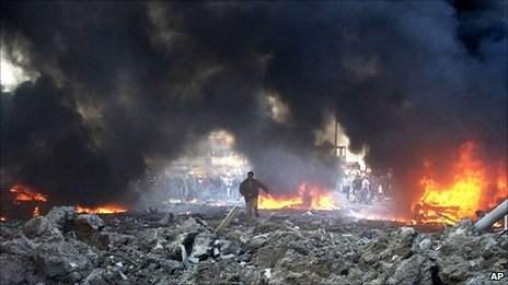 Vehicles burn in Beirut after the bomb attack which killed Rafiq Hariri, 14 February 2005