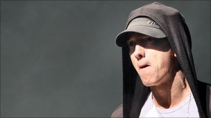 Eminem reclaims UK chart top spot