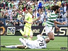 Seattle goalkeeper Terry Boss hauls down Georgios Samaras