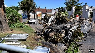 Torched cars and toppled street signs in Saint-Aignan, central France, 18 Jul 10