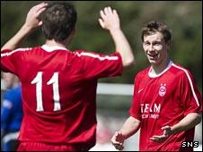 Mitch Megginson (right) celebrates his goal against Peterhead