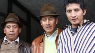 Ricardo Chaluisa, left, president of the La Cocha community, together with other members