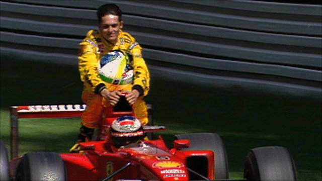 Michael Schumacher gives Giancarlo Fissichella a lift back to the pits