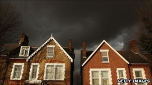 Houses under dark skies