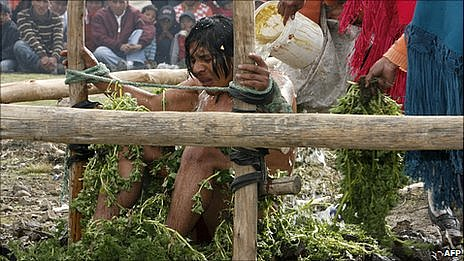 Alleged murderer Orlando Quishpe is punished by being bathed with cold water and flogged with stinging nettles by members of his community La Cocha, in Zumbahua, Ecuador.