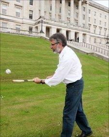 Gerry Adams shows his hurling skills