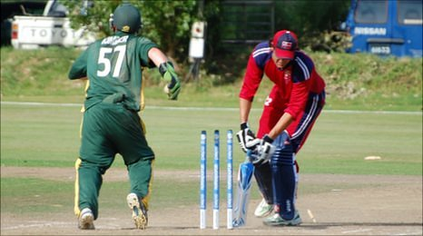 Norway's last wicket falls as Guernsey wicketkeeper Tom Kimber celebrates