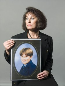 Ann Oakes-Odger with a picture of her son