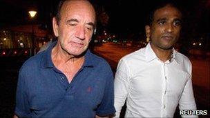 Alan Shadrake and his lawyer M Ravi leave the remand centre after bail was granted, early 20 July 2010, Singapore