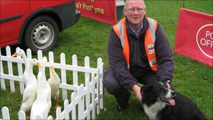 Postman David Power with sheepdog Glen