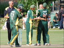 Guernsey cricketers celebrate beating Norway and winning the ICC European Division Two Championship