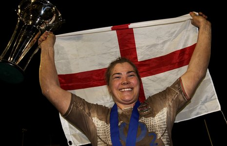 Catherine Spencer celebrates leading England to their fifth straight Six Nations title in March