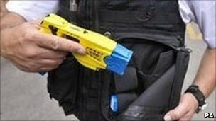 Officer with a Taser gun