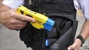 Officer with a Taser gun
