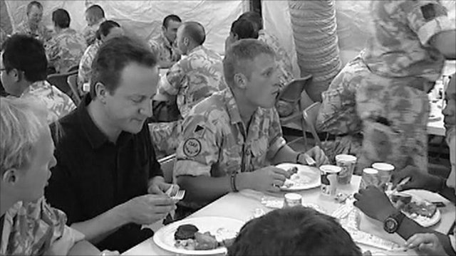 David Cameron eating with troops in Afghanistan