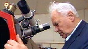 Patrick Moore looks through his own telescope