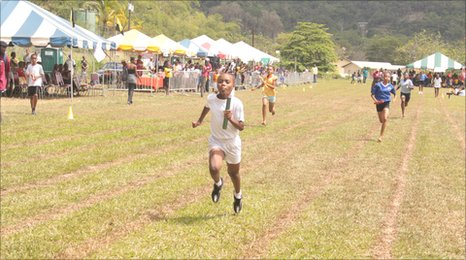 Children run for the finish line in the relay