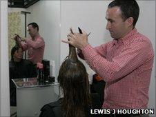 Alan Grieve cutting hair