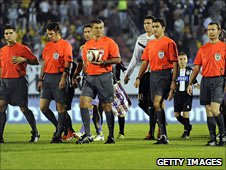 Five officials take to the pitch