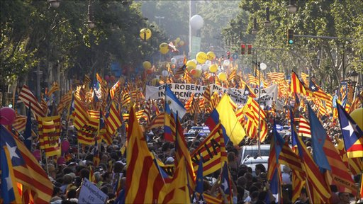 People take to the streets with Catalan flags during a protest for greater autonomy within Spain in central Barcelona
