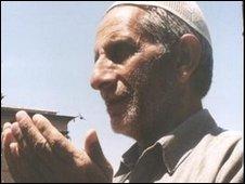 A Muslim man praying at mosque.
