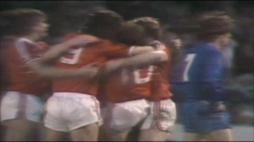 Welsh players celebrate Mark Hughes' goal