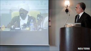 ICC Chief Prosecutor Luis Moreno-Ocampo looks at a video of Omar al-Bashir, 13 July 2010.