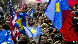 """Kosovans wave flags during """"independence day"""" celebrations in Pristina in 2009"""