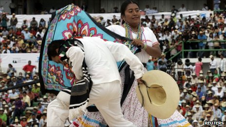 "Dancers, wearing their traditional clothing, perform on stage at the ""Guelaguetza"" festival in the southern city of Oaxaca July 19, 2010"