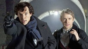 Benedict Cumberbatch (L) and Martin Freeman as Sherlock Holmes and Watson