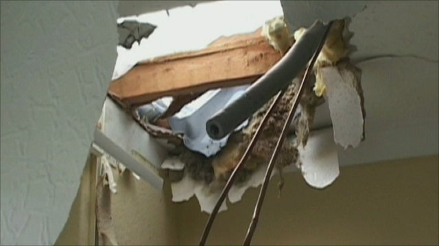 Damage to the ceiling caused by the ice block