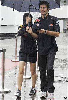 Mark Webber arrives for a media conference