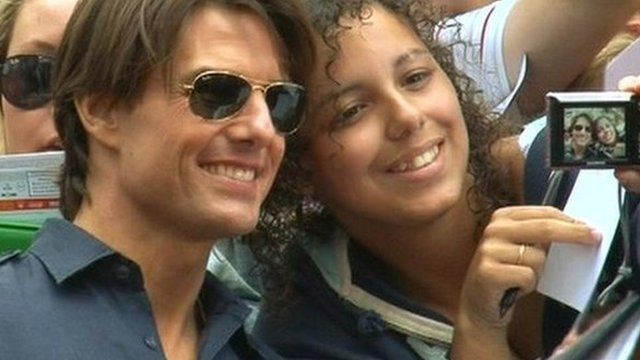 Tom Cruise and a fan in London's Leicester Square