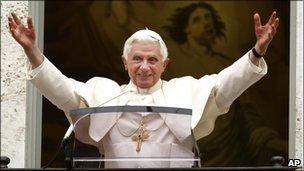 Pope Benedict XVI greets the faithful during the Angelus prayer at Castel Gandolfo, on the outskirts of Rome