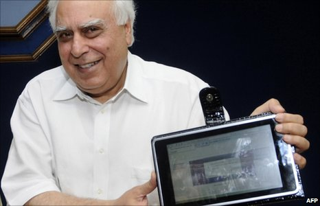 Indian Minister for Human Resource Development Kapil Sibal unveils the &quot;laptop&quot; device in Delhi on 22 July 2010