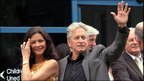 It was Michael Douglas's turn to offer a wave as the couple left the hospital following their visit.