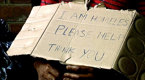 Homeless man with a sign