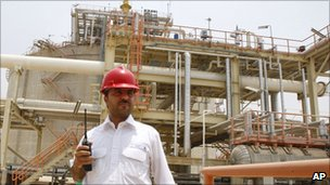 An Iranian worker stands in front of the partially constructed site which is part of South Pars gas field. Photo: July 2010
