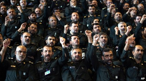 Iranian Revolutionary Guard commanders chant slogans during a meeting with President Mahmoud Ahmadinejad. File photo