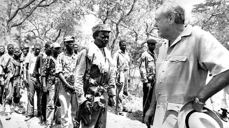 Lord Soames inspects guerrillas in Rhodesia, just before the change to majority rule. (file photo from January 1980)