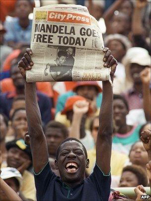 Man holding newspaper on the day Nelson Mandela was set free