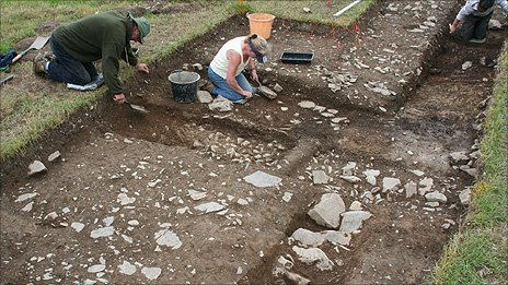 Archaeologists dig showing the excavated walls of the villa