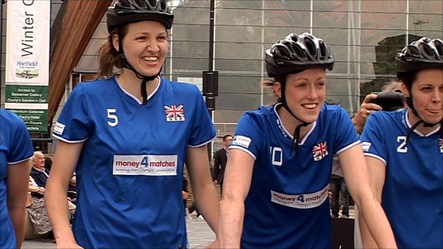 GB women's volleyball team on bikes