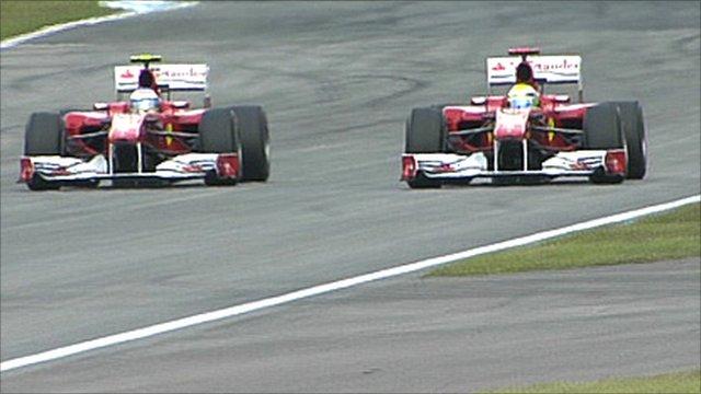 Fernando Alonso passes Felipe Massa